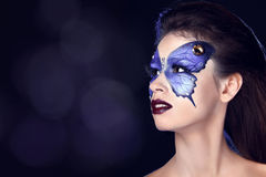 Fashion Make up. Butterfly makeup on face beautiful woman Royalty Free Stock Photography