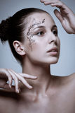 Fashion make-up with face art. Stock Image