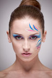 Fashion make-up with face art. Stock Photos