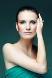 Fashion make up with green dress Royalty Free Stock Image
