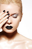 Fashion make-up. Shiny oil skin, black lips, nails Stock Image