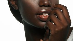 Fashion makeup. Close-up of  lips African American young woman. Studio shoot Royalty Free Stock Photo