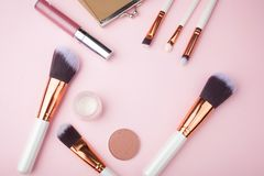 Fashion Makeup Cosmetic accessories on pink background. Top view. Flat lay. Royalty Free Stock Photos