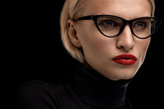 Fashion Makeup Model With Red Lips And Black Eyeglasses Frame. Fashion Makeup Model With Red Lips And Black Eye Glasses. Beautiful Woman Face With Red Stock Photo