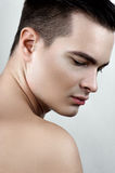 Fashion male with drops on face Royalty Free Stock Image