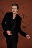 Fashion male model. Posing in black suit Stock Image