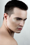 Fashion male model with drops on face. Fashion male with drops on face Stock Photos