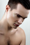 Fashion male model with drops on face Stock Photography