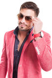 Fashion male model fixing his sunglasses Stock Photography