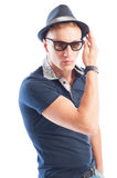 Fashion male model wearing blue t-shirt, hat and sunglasses Stock Photos