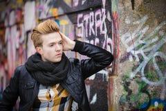 Fashion male portrait on graffiti wall Stock Photography