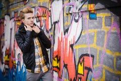 Fashion male portrait on graffiti wall Royalty Free Stock Photography