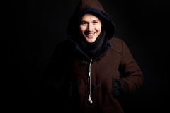 Fashion male portrait with a hodded coat Royalty Free Stock Photography