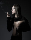 Fashion male smoking a cig Royalty Free Stock Photography