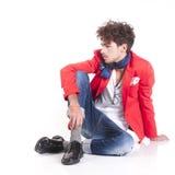 Fashion man. Une isolated fashion man sit on white background Royalty Free Stock Image
