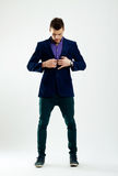 Fashion man buttoning his coat Royalty Free Stock Photo