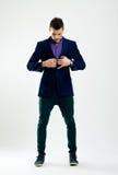 Fashion man buttoning his coat royalty free stock photo