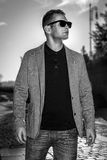 fashion man in casual clothes and sunglasses walking in city Royalty Free Stock Photos