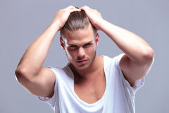 Fashion man closeup holding his hair Royalty Free Stock Photo