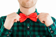 Fashion man correcting his tie Stock Images