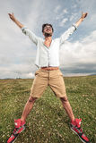 Fashion man enjoying life and freedom outdoor Stock Image
