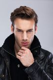 Fashion man face close up, over gray background Royalty Free Stock Photography