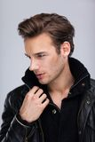 Fashion man face close up, over gray background Royalty Free Stock Photos