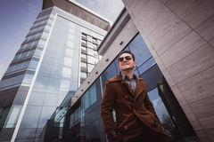 Fashion man in front of a glass building Stock Images