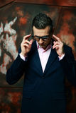 Fashion man in glasses standing over industrial Royalty Free Stock Photo