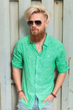 Fashion man in green shirt with long beard Royalty Free Stock Image