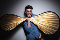 Fashion man having fun with a big bow tie Stock Images