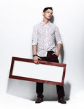 Fashion Man holding Board with White Blank Space for Text Stock Image