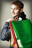Fashion man holding shopping bags Royalty Free Stock Photography