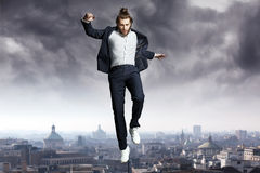 Fashion man jumping to the sky Stock Images