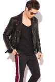 Fashion man in leather jacket and sunglasses looking down. On white background Royalty Free Stock Photo
