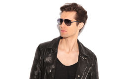 Fashion man in leather jacket and sunglasses looking to side Royalty Free Stock Photography