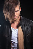 Fashion man with long hair looking at the camera Stock Images