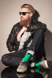 Fashion man with long red beard sitting Stock Image