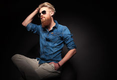 Fashion man looking up while fixing his hair Royalty Free Stock Image