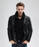 Fashion man, model leather jacket, gray background Stock Images