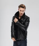 Fashion man, model leather jacket, gray background Stock Photos