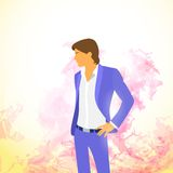 Fashion man over colorful paint splash background Stock Photography