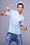 Fashion man pointing at himself Royalty Free Stock Photography