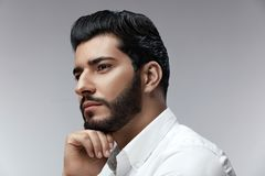 Fashion Man Portrait. Male Model With Hair Style And Beard. Handsome Man With Beauty Face. High Resolution stock photography