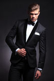 Fashion man posing in tuxedo Royalty Free Stock Photography