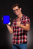 Fashion man presenting a new tablet pad Royalty Free Stock Image