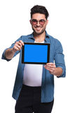 Fashion man presenting a tablet computer Royalty Free Stock Photography