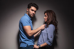 Fashion man pulling his girlfriends collar Stock Photo