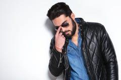 Fashion man pushing his sunglasses back on Stock Photo
