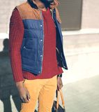 Fashion man in a red knitted sweater, vest jacket royalty free stock photography